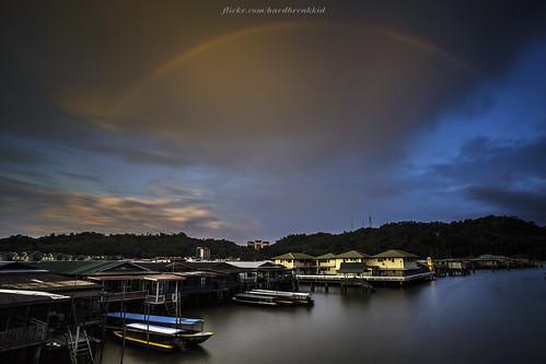 longexposure bridge blue sunset house water yellow clouds canon landscape boats eos skies nd 20mm brunei manfrotto nd400 veniceoftheeast watervillage bruneiriver kgayer 5dmkii sungaikebun