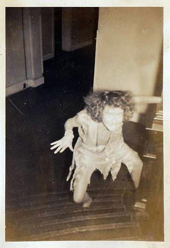 Creepy woman climbs the stairs