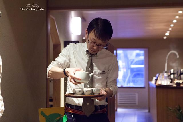 Male staff member pouring the prepared Sencha teas