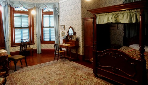 Collingrove House owned by the National Trust near Angaston. Once the family home of John Howard Angas son of a founder of SA George Fife Angas. This bedroom is in the 1870s wing of the house which was started in 1856. Four poster bed.