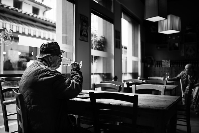 The man with hat and wine glass