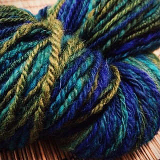 Navajo-plied Blue Leicester wool. I'm getting a bit more consistent with practice, but it's still a little uneven. #spinning #vscocam | by iwriteplays
