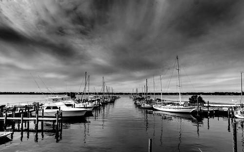 monochrome black white sea boats sony a6000 rokinon 10mm f8 dock orange beach alabama