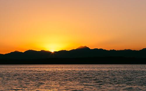 pacificnorthwest olympicmountainrange landscape elliotbay pugetsound water evening sunset seattle westseattle canoneos5dmarkiii canon135mmf2lusm mountains cloudy johnwestrock washington