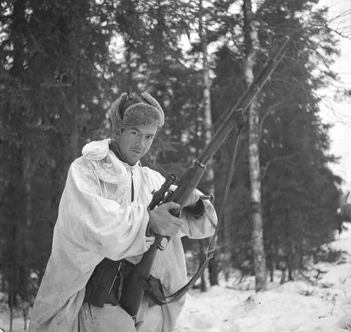 Finnish soldier  Simo Hjajuhi  with a captured Soviet  mosin nagant sniper rifle near Jarvenpaa Finland 19.12.1939.