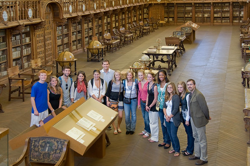 Students pose at a library