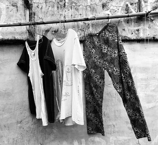 People hang out clothes to dry in the alleys if Kemang. There are nails in the walls, then a string or a bamboo stick is enough to put the clothes to dry. The air is less polluted in these alleys and clothes dry very quickly #streetphotography #jakarta #i | by Arnaldo Pellini Photographs