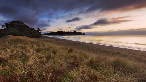 newzealand panorama seascape beach clouds sunrise dunes nz coromandel eastcoast hahei hotwaterbeach leefilters nikond800 lee06gndsoft nikkor160350mmf40 solmetageotaggerpro6