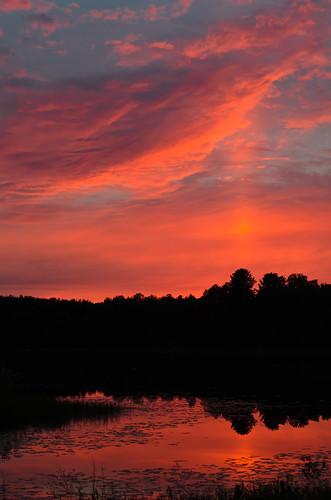 pink blue sunset sky orange sun lake reflection water silhouette clouds landscape evening glow michigan column blaze