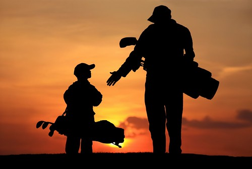 Dad_son_orange_sunset