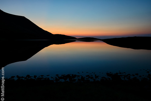 blue brecon breconnationalpark lake llynyfanfawr mountains nationalpark red rock sunset wales water dusk remote wilderness