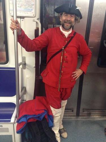 A red Miquelet reenactor in the metro | by Liz Castro