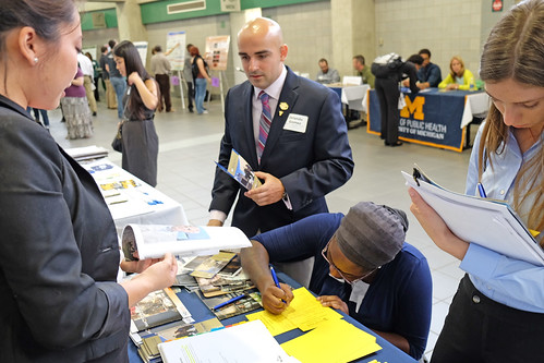 Students speak with Graduate School representatives at the Summer Undergraduate Research Forum at the Breslin Center. (Photo/D.L. Turner)
