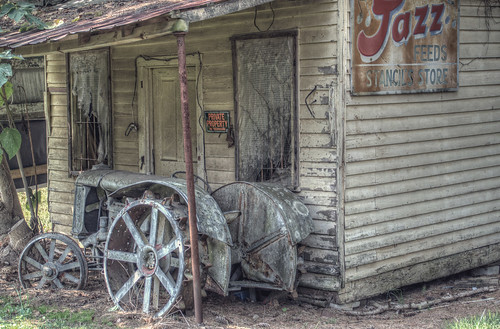 old usa tractor building abandoned architecture rural vintage georgia store nikon closed unitedstates antique decay south country rusty architectural southern faded adobe boardedup generalstore derelict mica shady smalltown lightroom countrystore fordson cherokeecounty fordmotorcompany farmequiptment ballground stancilsstore d7000 stgrundy henryfordson
