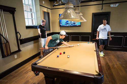 Students play pool in Zick's pizza restaurant