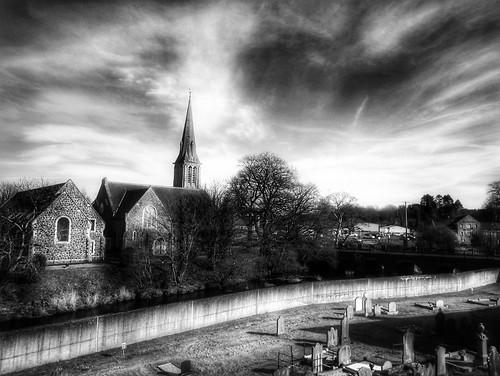 cullybackey northern ireland uk black white monochrome ulster church bridge graveyard headstone river village