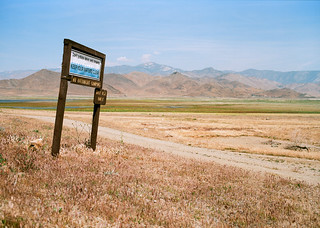 A sign at Lake Isabella reminds me to keep our waters clean as I ride into the dried up lake bed. The state of California's water supply cannot be more clearly depicted. April 2015 | by thewronski