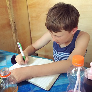After breakfast at our local Warung is Seb's favorite time of the day. He has to spent time writing in his diary. He just loves it. NOT! | by UpSticksNGo