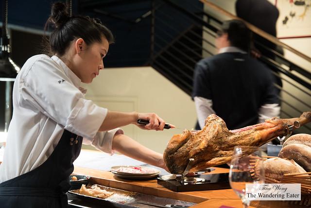 Chef Tracy Chang slicing the Iberico jamon