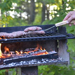 Grilling burgers at Occoneechee State Park Cabin 11