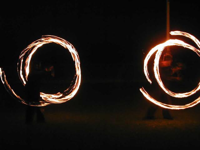 Circles made with fire poi on Brighton beach