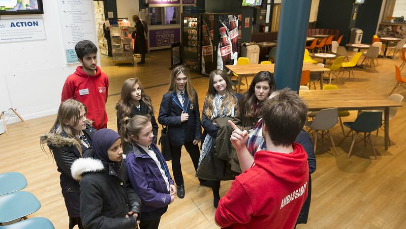 ambassadors talking toa group of young students