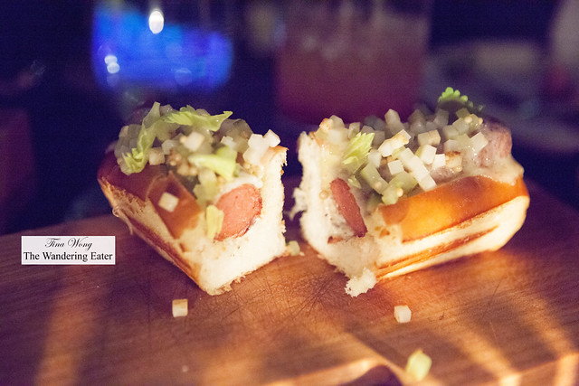 Bacon-wrapped hot dog with black truffle & celery