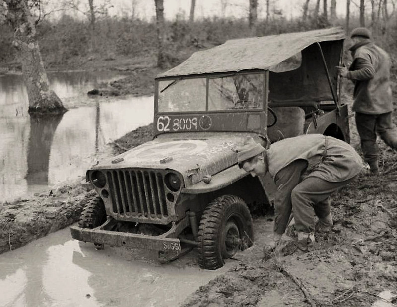 Crew of a jeep attempt to dig out their vehicle