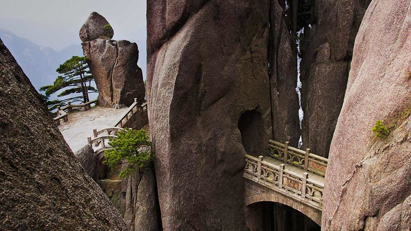 Bridge in the Huangshan Mountain range, Anhui province, China (© Frank LukasseckCorbis)