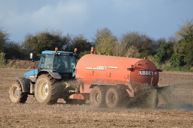 New Holland TM150 Tractor with an Abbey Twin Axel Vacuum Slurry Tanker