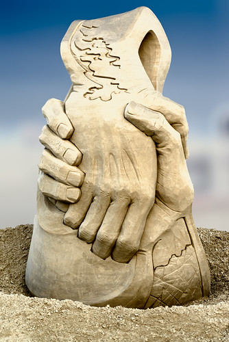 Hands Clasped in Sand