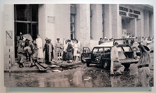 "10 March 1965: ""Aftermath of the bombing at MacDonald House during the height of the Indonesian Confrontation."" Photo by Kok Ah Chong, displayed at the National Museum Singapore"
