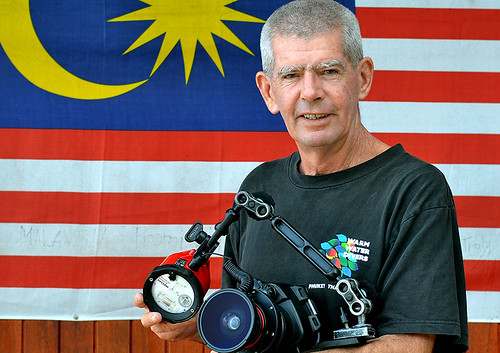 Grahame in front of  the flag of Malaysia   by grahamemassicks