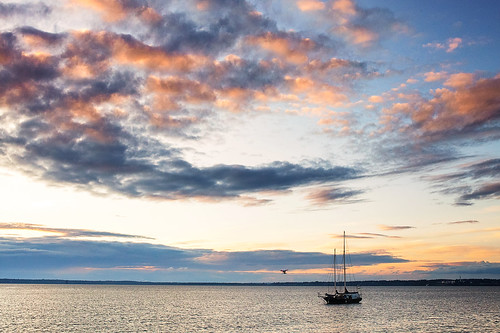 ocean sunset sky sun water colors clouds sailboat boat washington cloudy bellingham