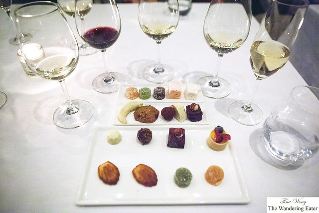 Our petit fours surrounded by my wall of wines