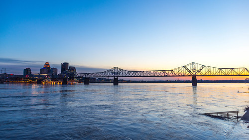 downtownlouisville ohioriver bridge river water sky skyscrapers skyline kentucky sunset downtown