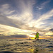 Then Tech. Sgt. Alfred Van Gieson, now Master Sgt., of 48th Aerial Port Squadron, 624th Regional Support Group, Joint Base Pearl Harbor-Hicka, paddles his outrigger canoe into the sunset off Kalaianaole Beach Park in Nanakuli, Oahu, Hawaii, Aug 9, 2016. Van Gieson is a veteran of Operation Iraqi Freedom, a world champion outrigger, or Va'a, paddler  and the coach at the Leeward Kai Canoe Club, which was founded by his grandparents. (U.S. Air Force photo by J.M. Eddins Jr.)