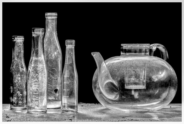 Glass items found and photographed under window light at an abandoned farm.