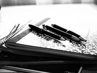 3 pens on a composition book | by Leslie Richards
