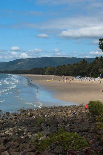 trees sea sky people beach water clouds palms rocks flags hills queensland portdouglas mountians austraila