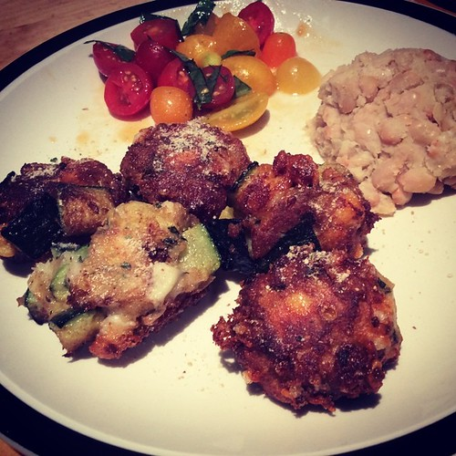 #kvpkitchen #vegetarian dinner w/ zucchini cheese balls, tomato salad and mashed garlic white beans. Last night's #kitchen adventure! NOM! #foodspotting #kvpinmybelly #foodstagram | by queenkv
