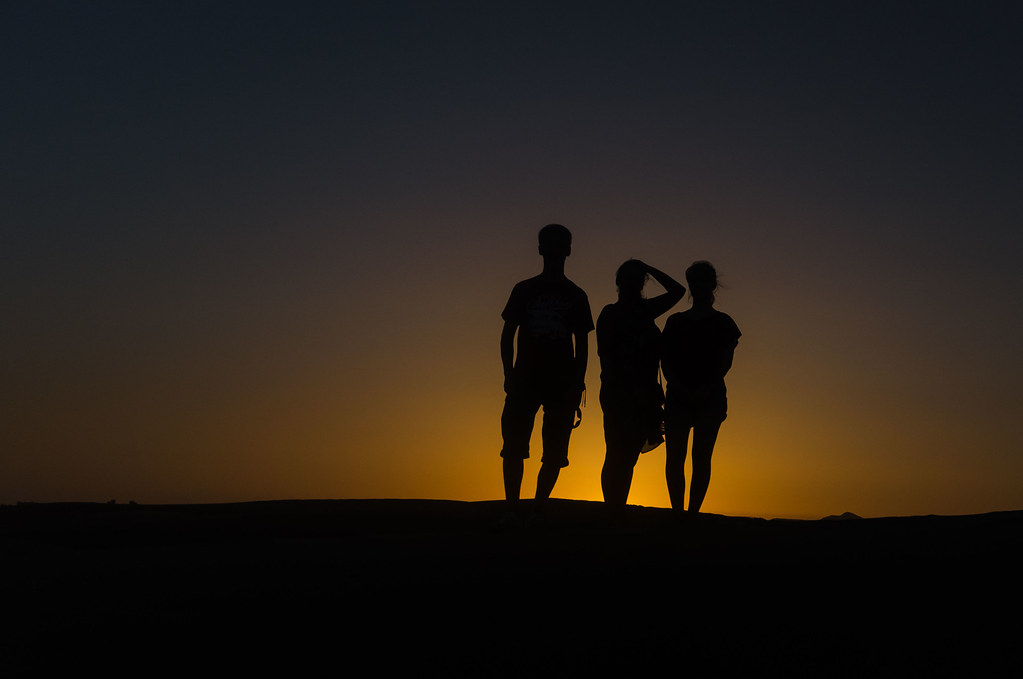 Silhouette of my family at Maspalomas sand dunes at sunset