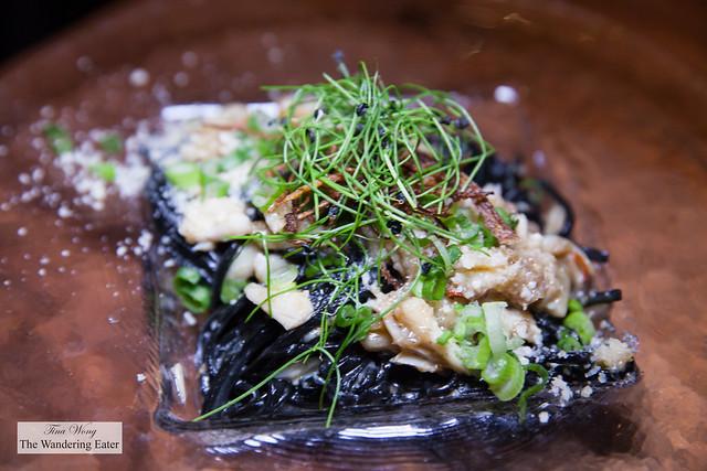 Angry crab, inked noodles, garlic, Thai basil & hot chiles, crispy bits, herbs, Parmigiano