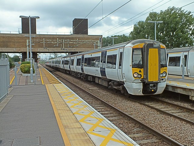 379 006 & 379 027 on a Greater Anglia Stansted Express working head towards Liverpool St at speed through Broxbourne Station, whilst 379 002 is looped on the up slow platform behind it. 13 07 2014