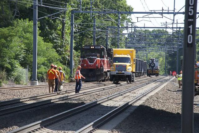 Crane is beside derailed cars