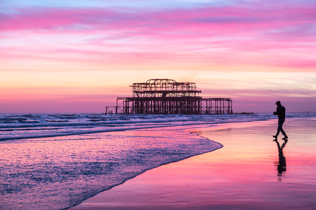 Brighton's West Pier at low tide and dusk