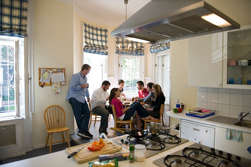 Students enjoy a meal at an overseas house