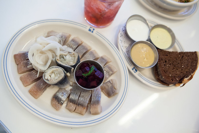 Herring sampler and plate of condiments
