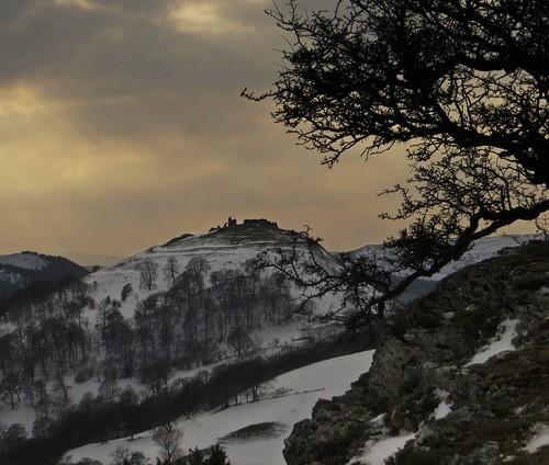castelldinasbran crowcastle panoramawalk offasdykenationaltrail romanticruin snowandsunset beautifuloldruin castlesilhouetteatsunset