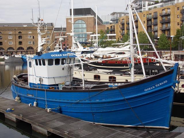 SAINT KATHERINES DOCK BLUE  FISHING BOAT NAMED  OCEAN REWARD MOORED IN LONDON ENGLAND DSCN0799